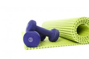 Purple Free Weights And Green Exercise Mat